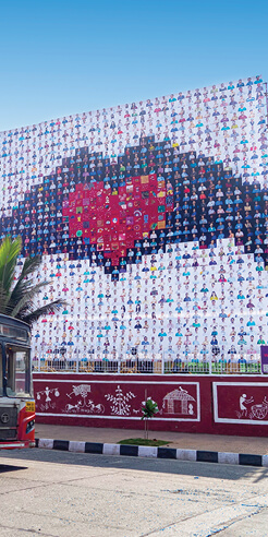 Corona quilts adorn facades of buildings and public spaces as an ode to humanity