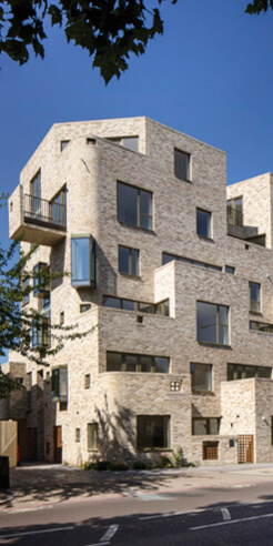 95 Peckham Road by Peter Barber Architects is a ziggurat-like stack of homes