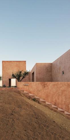 Casa Azul by Bak Gordon Arquitectos imbibes its vernacular Portugese landscape