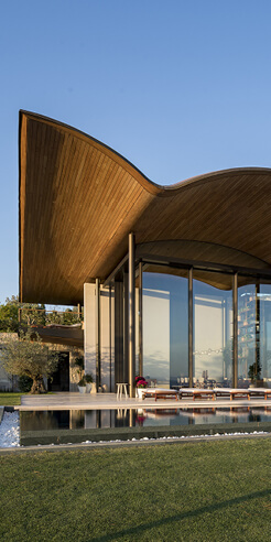 Foster + Partners designs Dolunay Villa in Turkey with handcrafted timber roof
