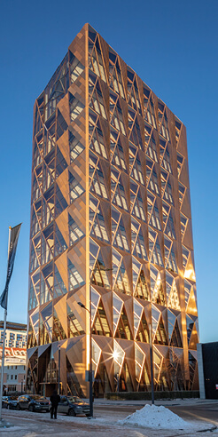 Foster + Partners' RCC Headquarters has a crystalline copper lattice inspired skin