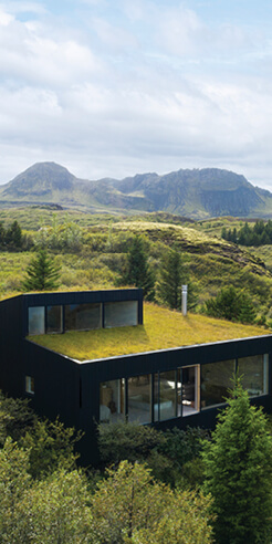 KRADS creates a lakeside holiday home that merges into the Icelandic countryside