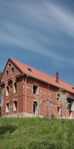 ORA adapts a ruined granary in Czech Republic into a graceful 'House Inside A Ruin'