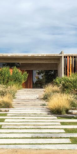 Besonías Almeida Arquitectos' Pilará House in Argentina fuses the rustic and modern