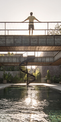Soaring cantilevers and rooftop walkways define Bond House by Alexis Dornier