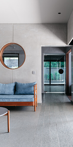 Studio Saransh injects VS House in India with subtlety, warm wood and grey tiles