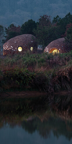 The Seeds by ZJJZ are oval holiday pods clad in aluminium tiles and pine shingles