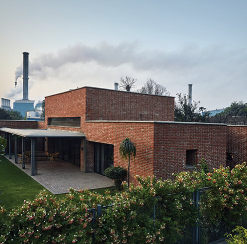 A look at Rajiv Saini + Associates' exposed brick home in the city of sugar mills in India