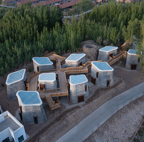 Grotto Retreat Xiyaotou by A()VOID cites the aboriginal architecture of Chinese caves