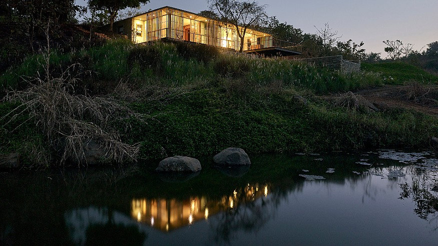 Architecture Brio designs a house on the water's edge rising over the ghats