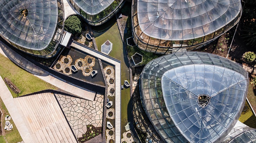 Greenhouses float on a simulated wetland inside El Tropicario by DARP in Colombia