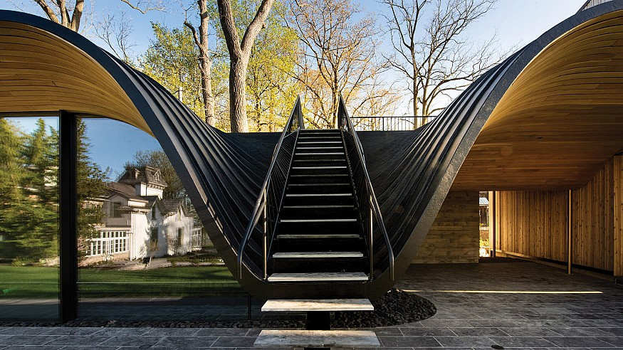 """This house by Partisans """"folds"""" into the contours of a Canadian hill site"""