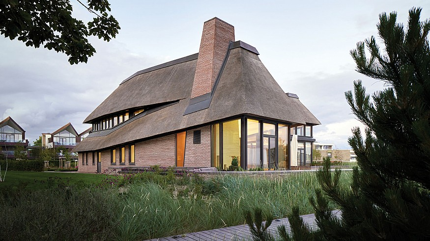 HUBSCHMITZ Architekten's holiday home in Föhr takes cues from Frisian farmhouses