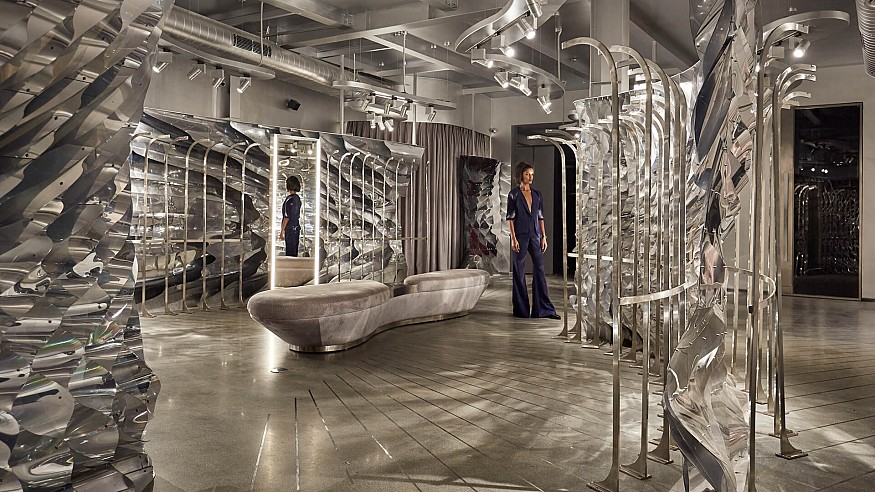 Orproject hangs reflective partition walls within Amit Aggarwal flagship store in Delhi