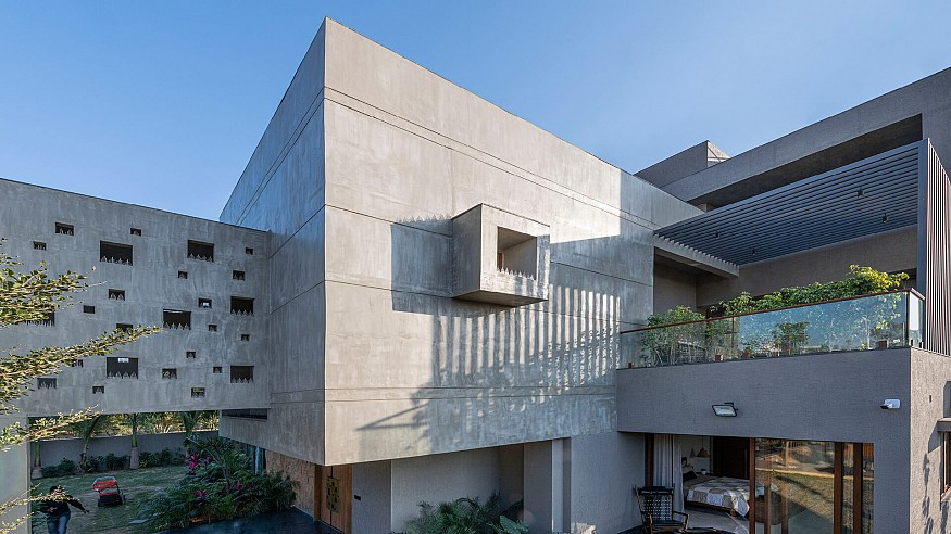 The Grid Architects erect sweeping concrete volumes with Pixel House in India