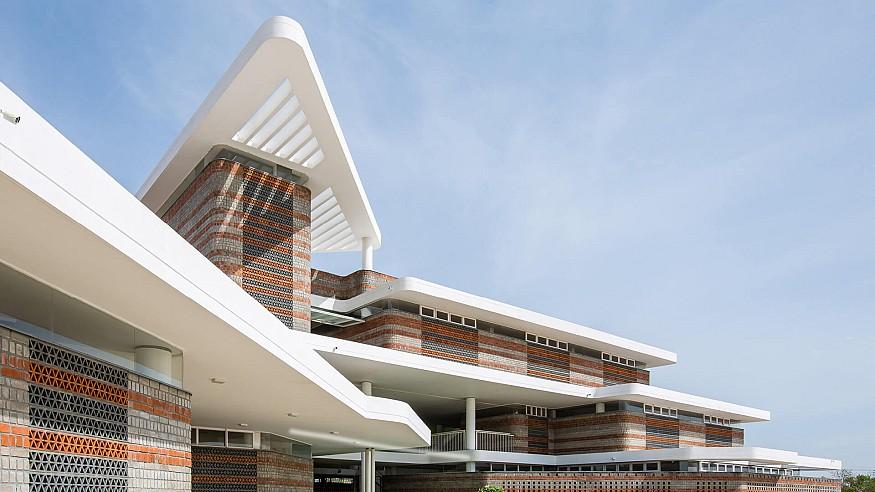 Shanmugam Associates designs a school  in India using alternate layers of local bricks