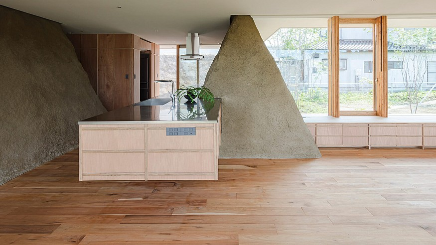 Soil House by ADX is propped on trapezoidal mounds of surplus soil from site