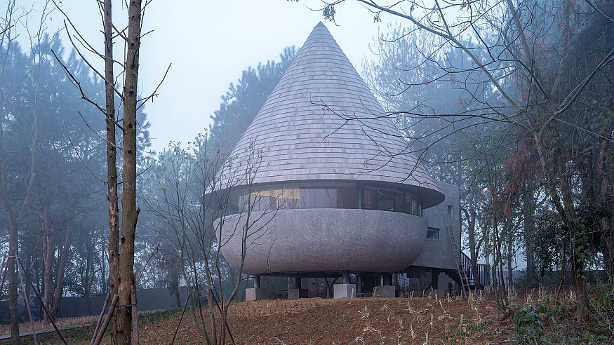 The Mushroom by ZJJZ is a cone-shaped guest house in the woods of Jiangxi, China