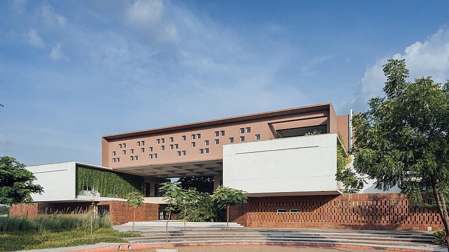 Green courtyards encircle learning zones in Shanmugam Associates' Northstar School