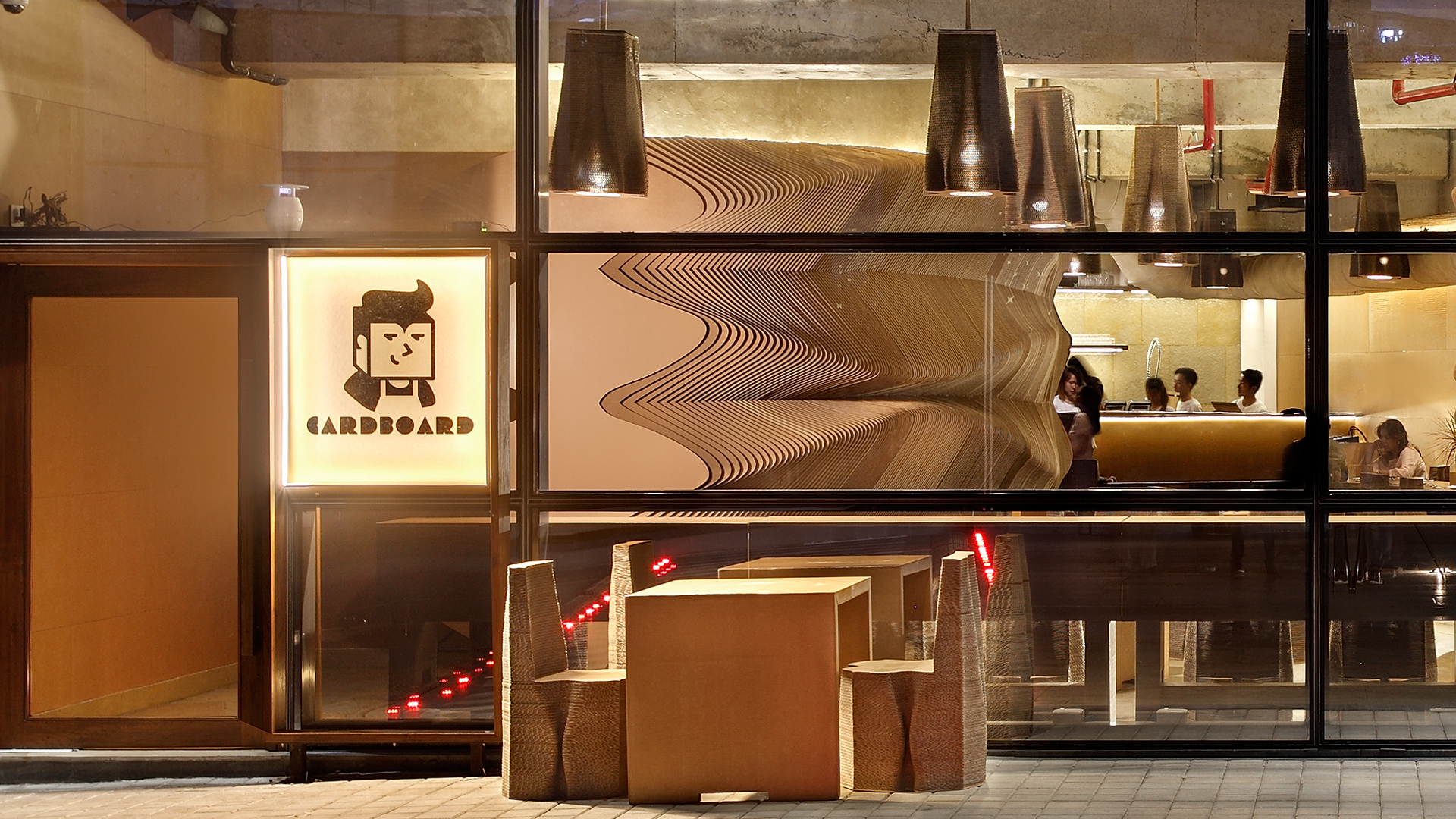A street-side view of the Cardboard café | Cardboard | Nudes | Nuru Karim | STIR