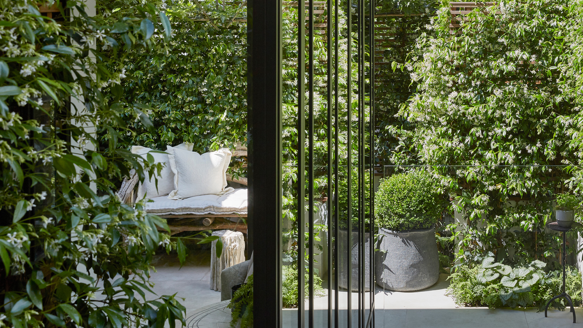Alt Text: Designer Louise Bradley's London home is surrounded by greenery| Louise Bradley| London| STIR