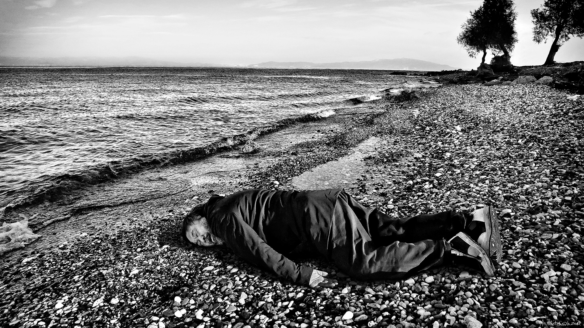 Chinese artist Ai Weiwei posing as drowned three-year-old Syrian refugee Aylan | Human Flow | Ai Weiwei | STIRworld
