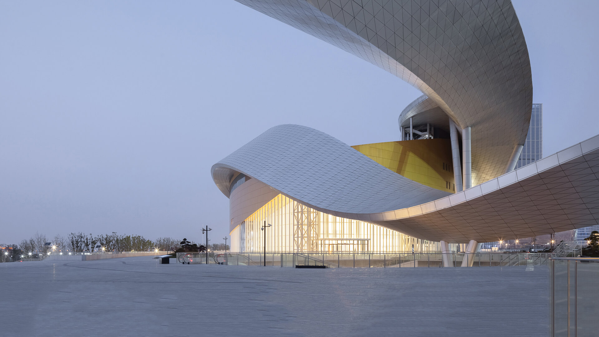 Christian de Portzamparc wraps Suzhou Bay Cultural Centre in a swirling ribbon