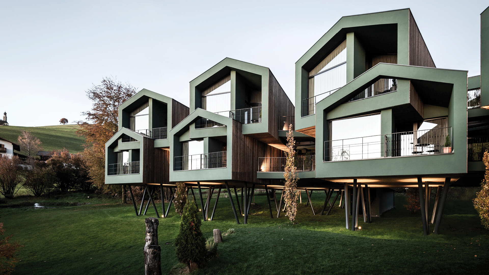 noa* designs an elevated cluster of treehouse suites for hotel Floris, Italy