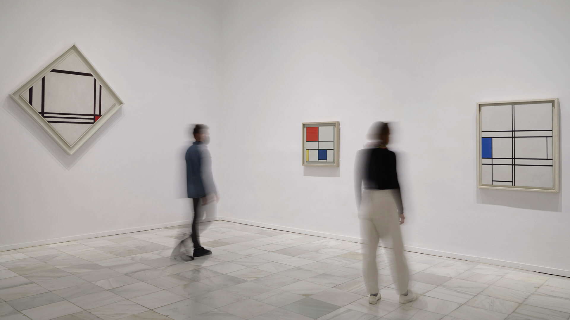 Mondrian and De Stijl, Museo Reina Sofia. L to R: Lozenge Composition with Eight Lines and Red (Pic No. 3), Composition C (No. 3) with Red, Yellow and Blue and Composition in Blue and White| STIRworld