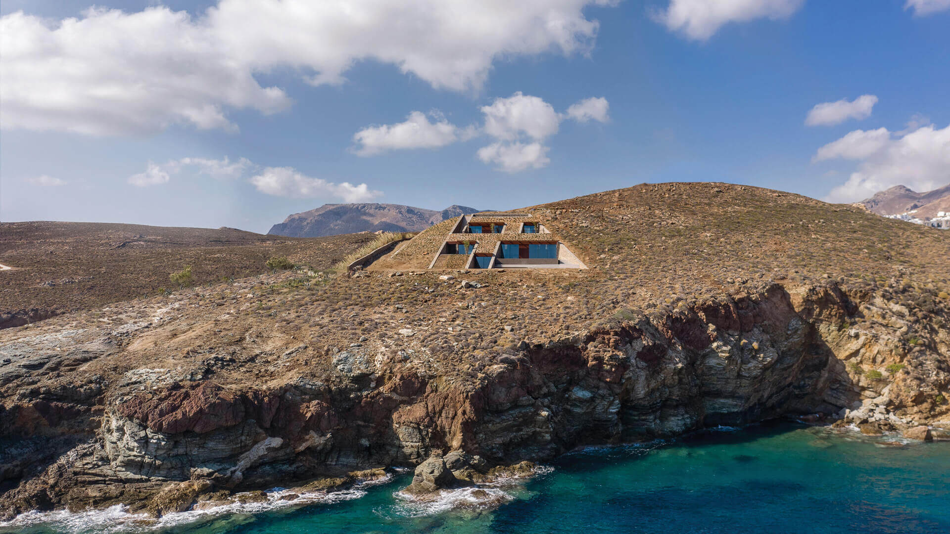 nCaved house designed by Mold Architects sits embedded on a rocky slope in a Greek island | nCaved House by Mold Architects | STIRworld