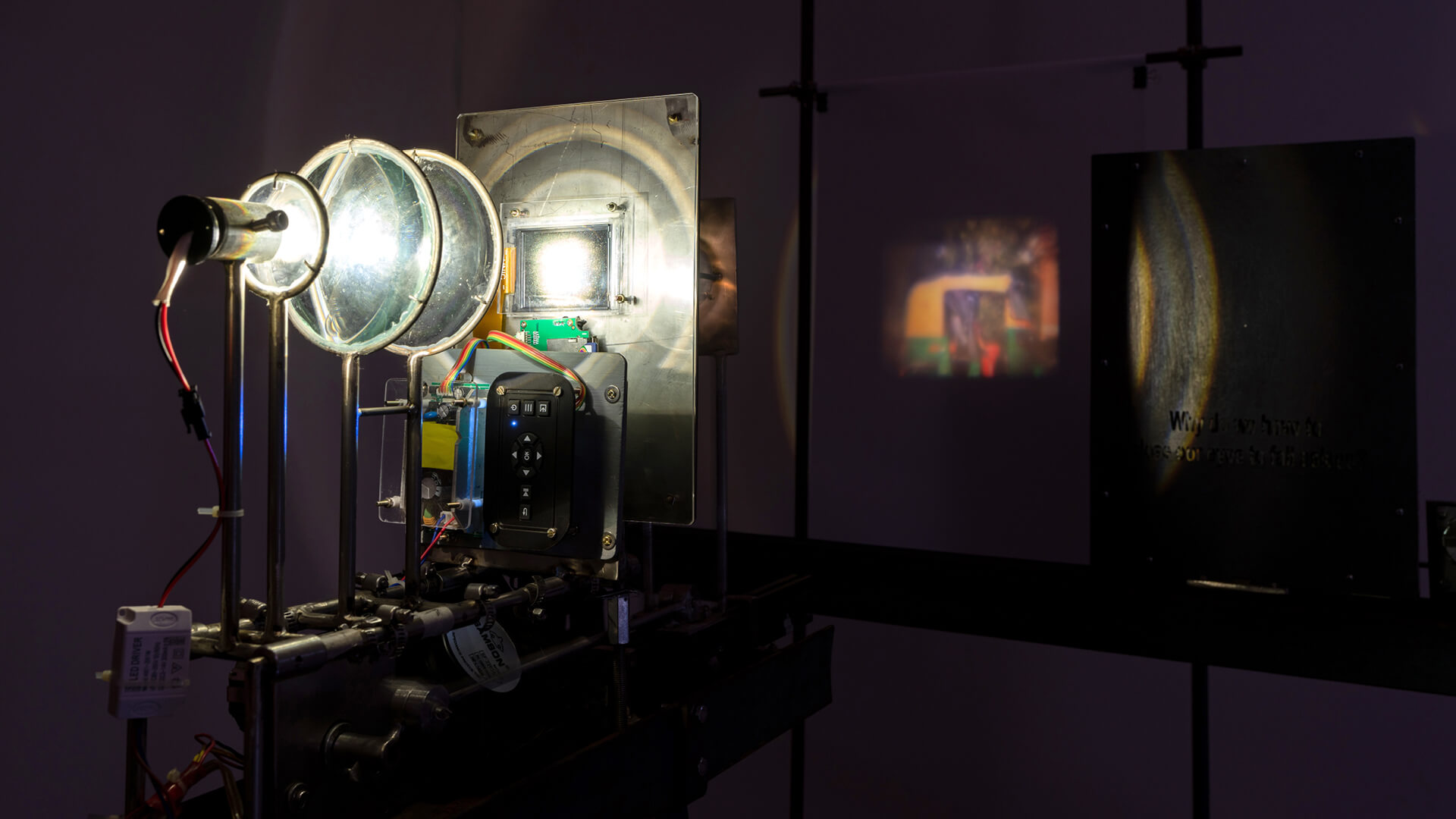 Susanta Mandal, Refrain, iron, steel, mechanical contraption, LCD screen, motherboard, light, motor and programming circuit, 2019 | Counter-Canon, Counter-Culture | Nancy Adajania | Serendipity Arts Festival | STIRworld