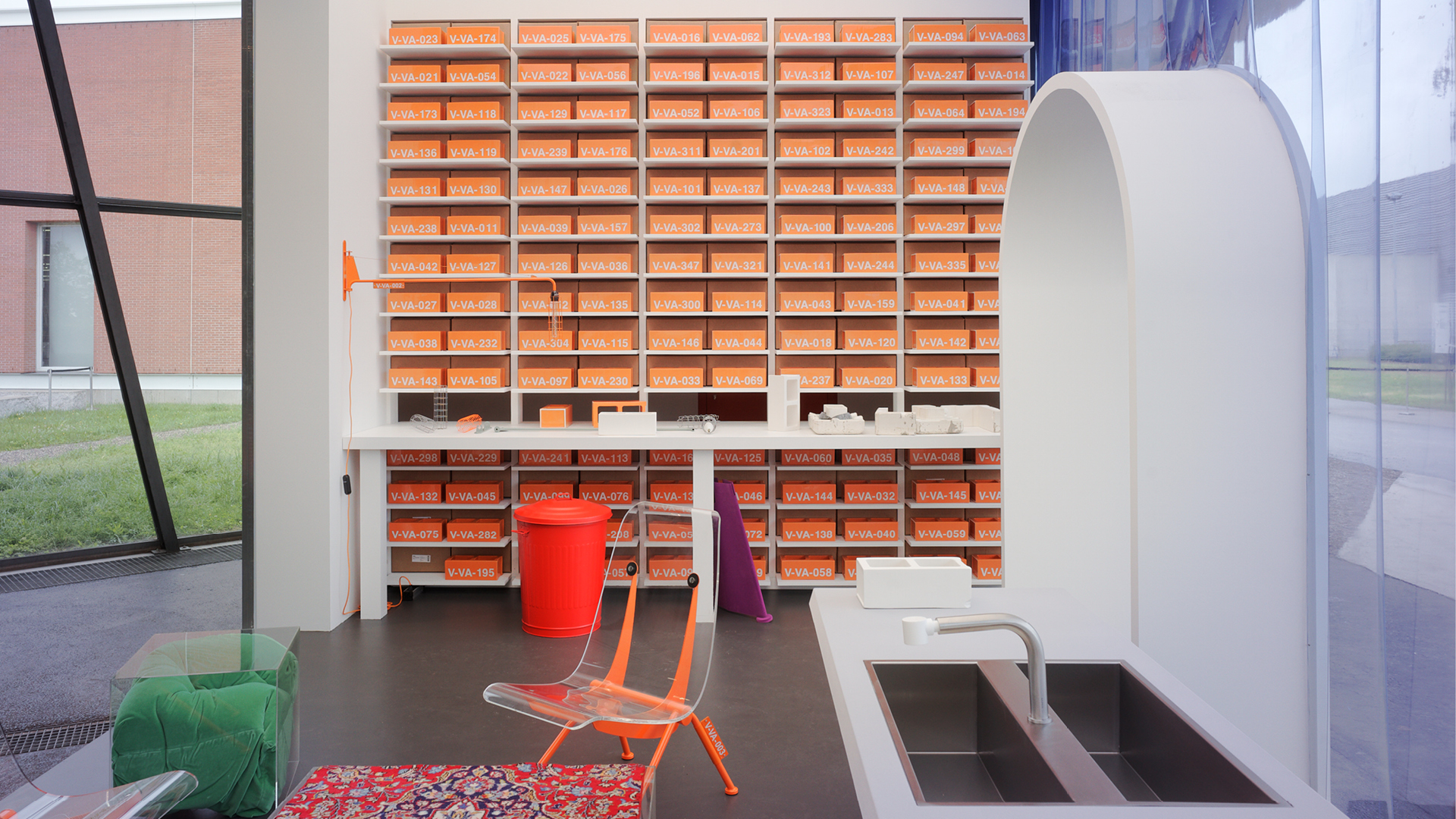 The centrepiece of the installation by Virgil Abloh for Vitra is a wall of 999 bright orange ceramic blocks| TWENTYTHIRTYFIVE| Virgil Abloh| Vitra| STIR