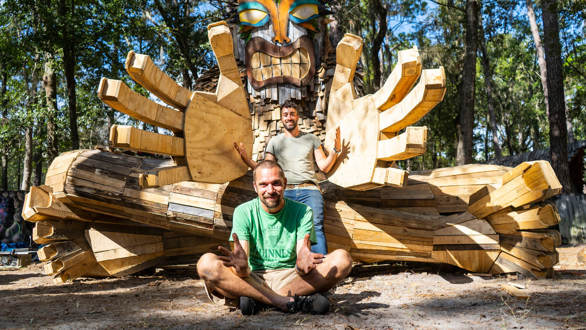 Thomas Dambo with his sculpture Zach The Shaman and an onlooker, created in Suwannee, Florida, 2018 | Zach The Shaman at Hullaween  by Thomas Dambo | STIRworld