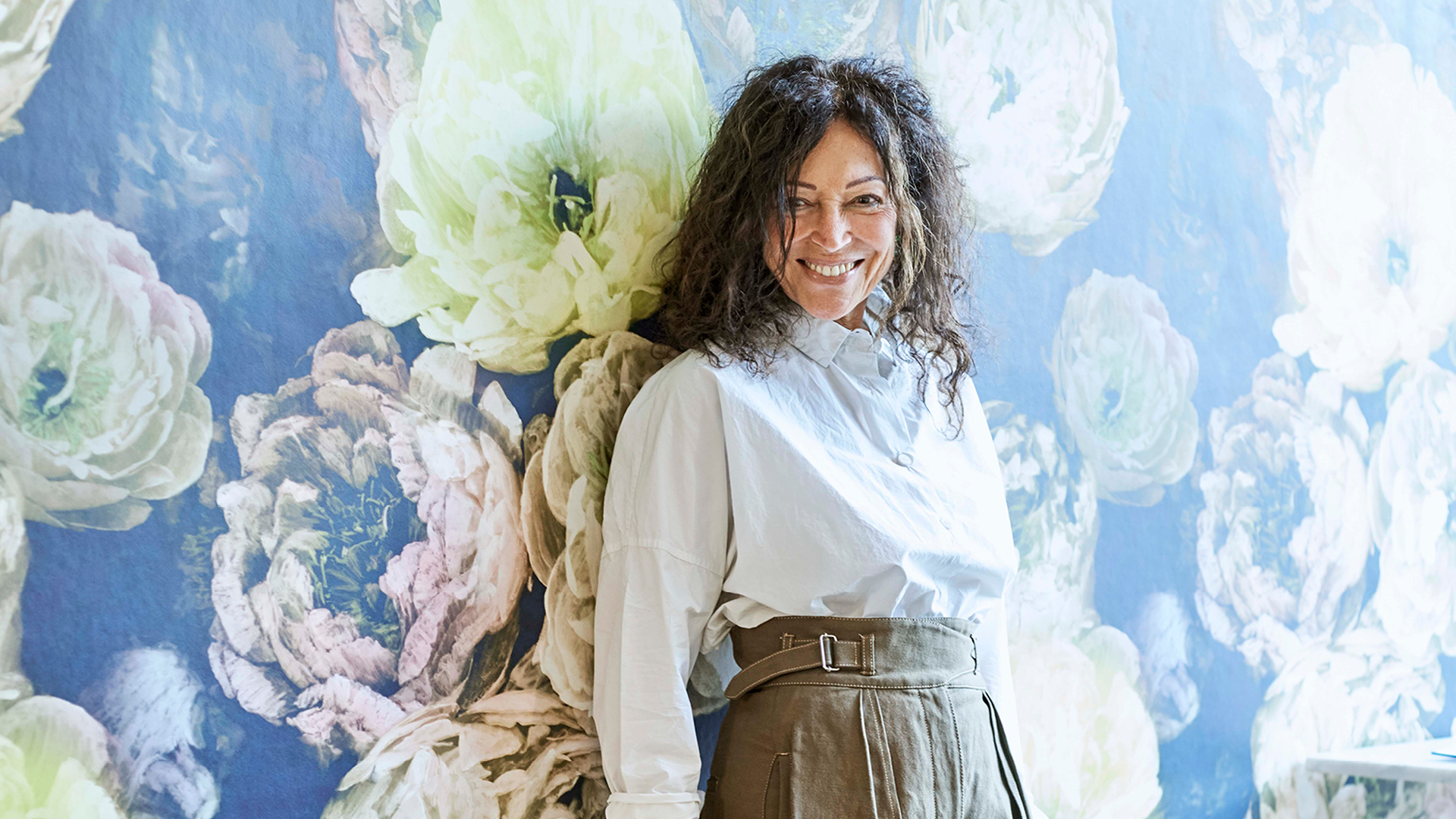 Tricia Guild OBE in front of a wallpaper from her Autumn/Winter 2019 collection | Tricia Guild| STIRworld
