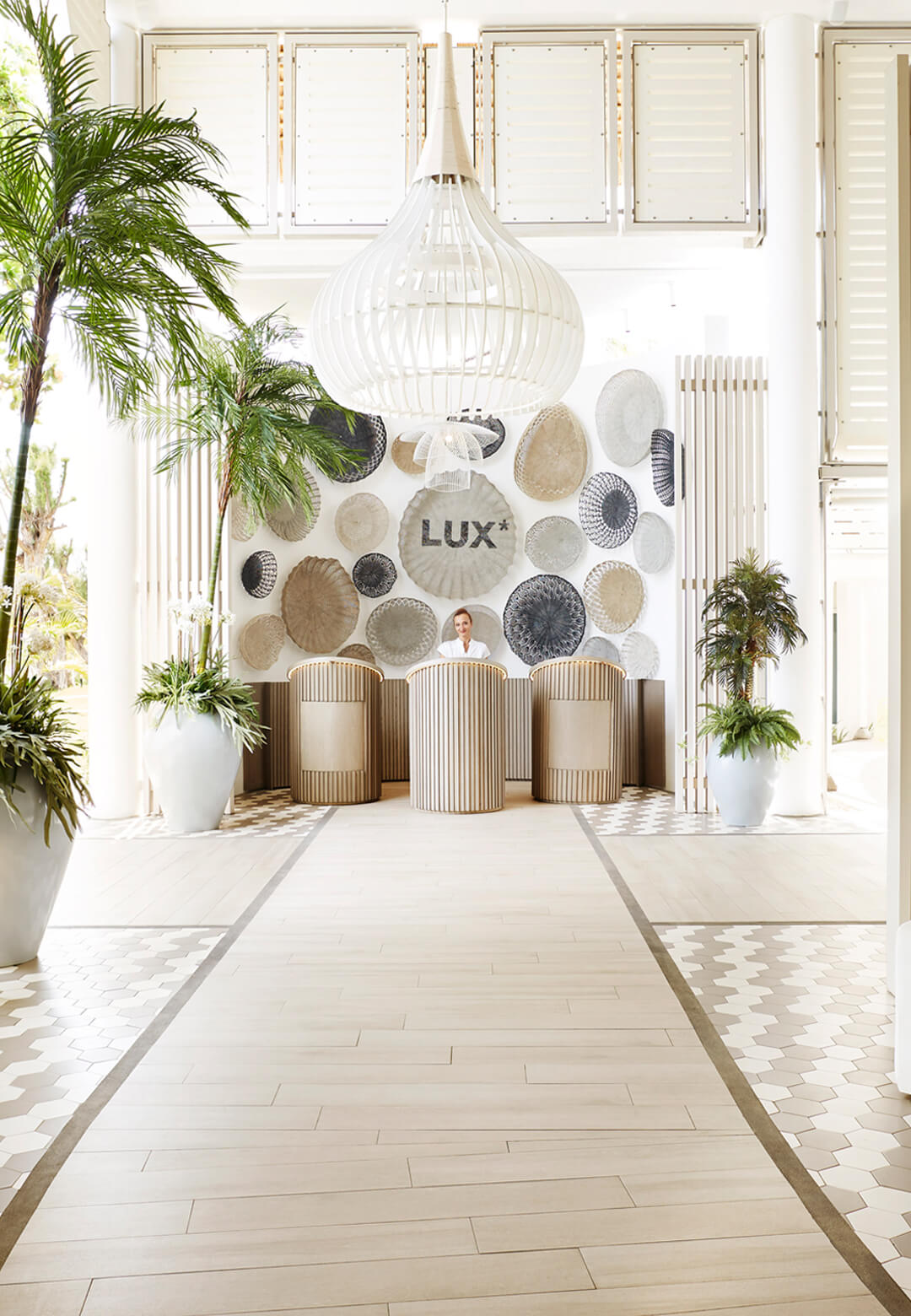 The guest reception area with its delicate cane detailing and light, contemporary ambience makes a stylish holiday statement.