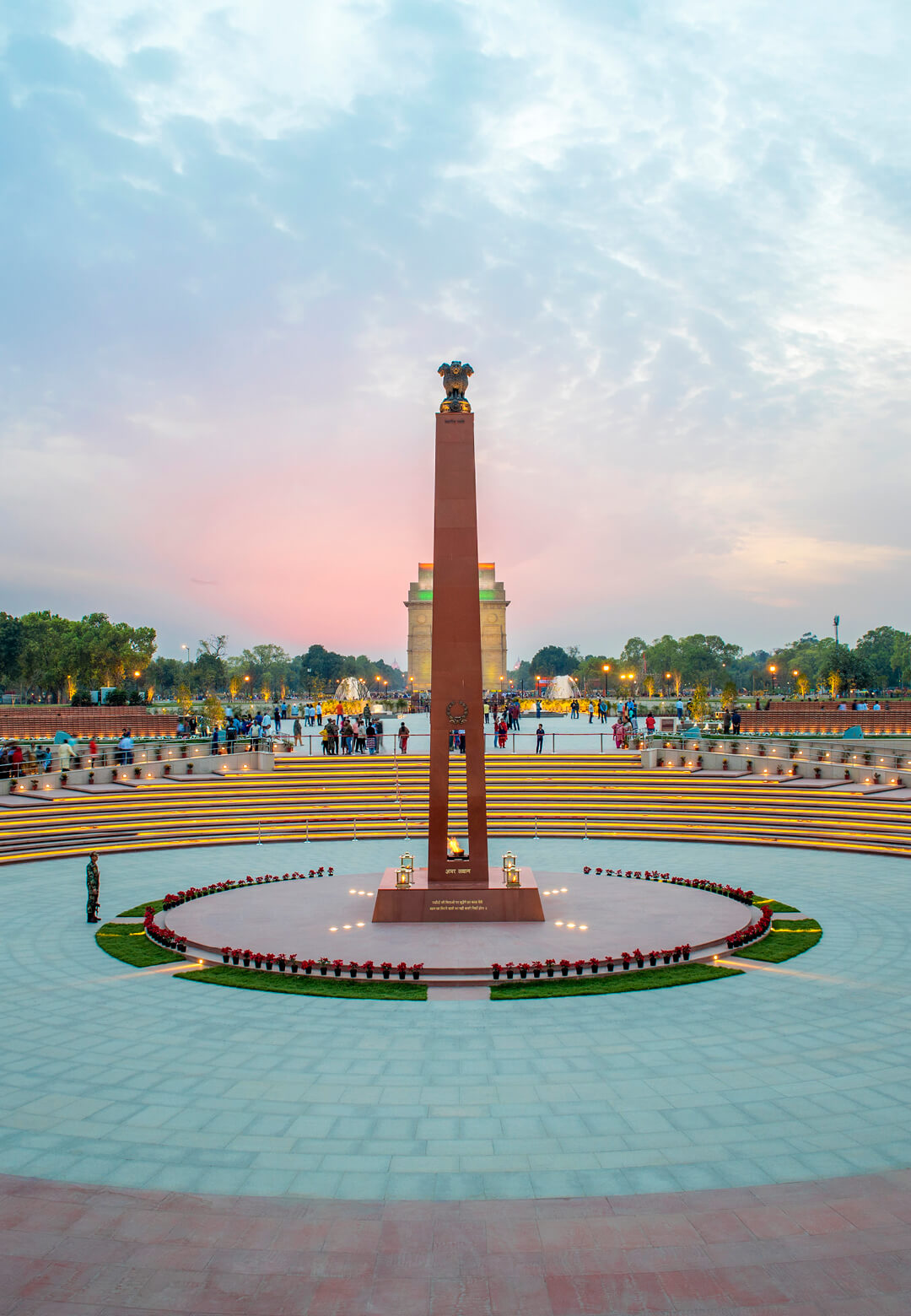 The obelisk of the Amar Chakra, or Circle of Immortality, with India Gate in the background