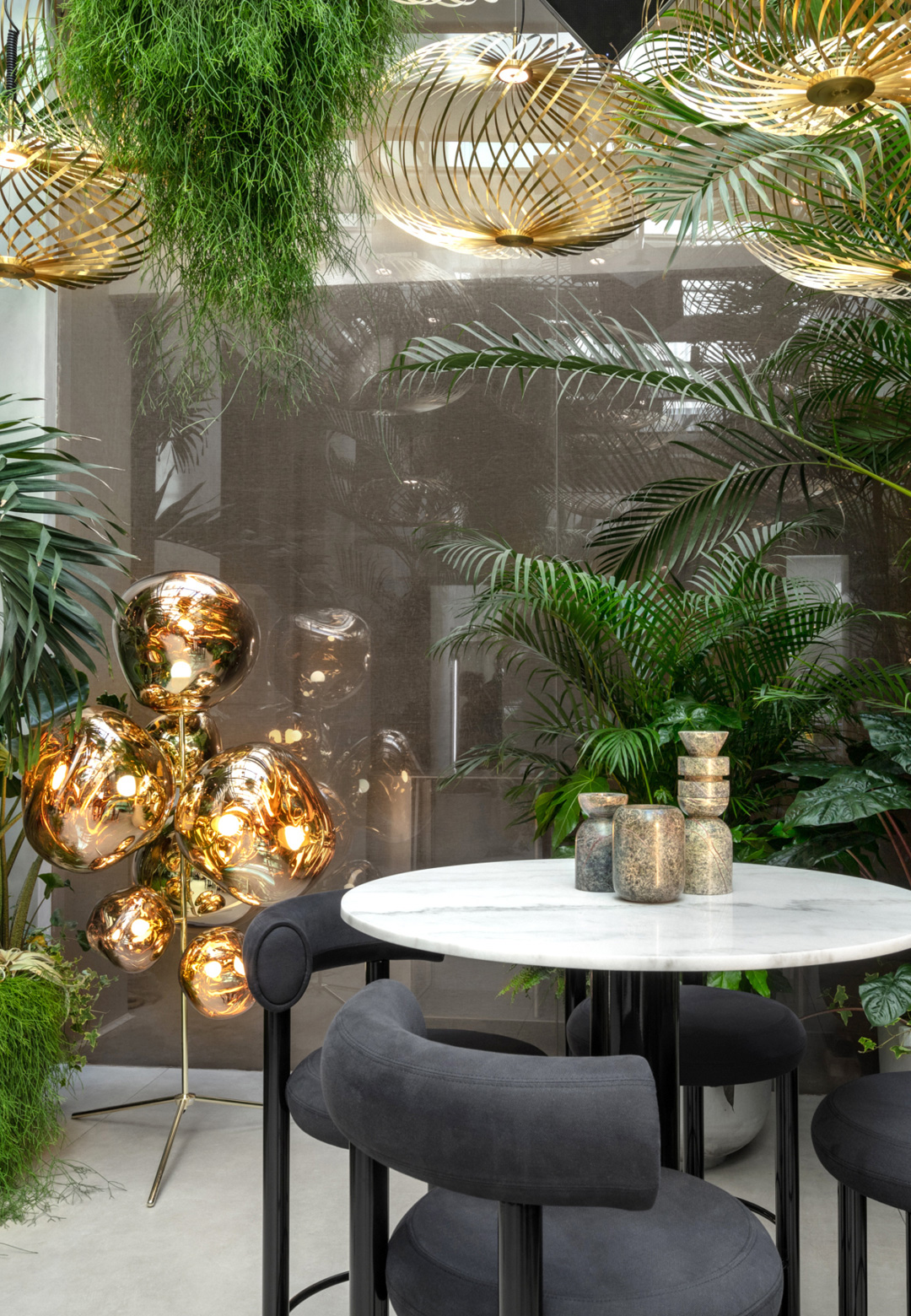 The Jungle room created by Art Flowers Gallery - here Spring pendants in brass hang down from the ceiling and Fat high stools are kept around a marble table| The Manzoni| Design Research Studio| Tom Dixon| STIR