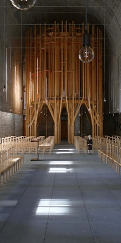 Forest-like wooden structure stands tall inside Imaculada Chapel in Braga
