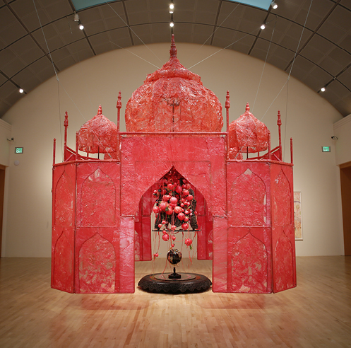 Rina Banerjee turns the Taj Mahal a soft red at the San José Museum of Art