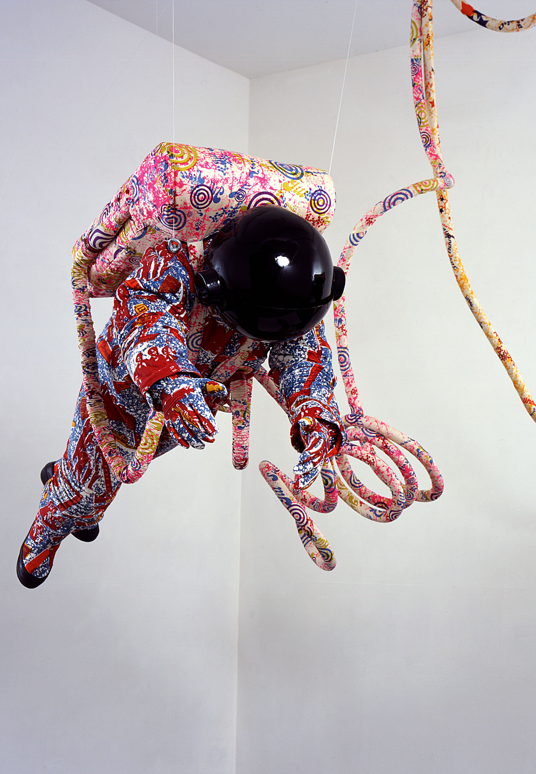 Yinka Shonibare CBE, Spacewalk, 2002, Screen printed cotton fabric, fiberglass, plywood, vinyl, plastic, steel, Stephen Friedman Gallery, London | Fly Me to the Moon. The Lunar Landing, 50 Years Later | Museum der Moderne Salzburg | STIR