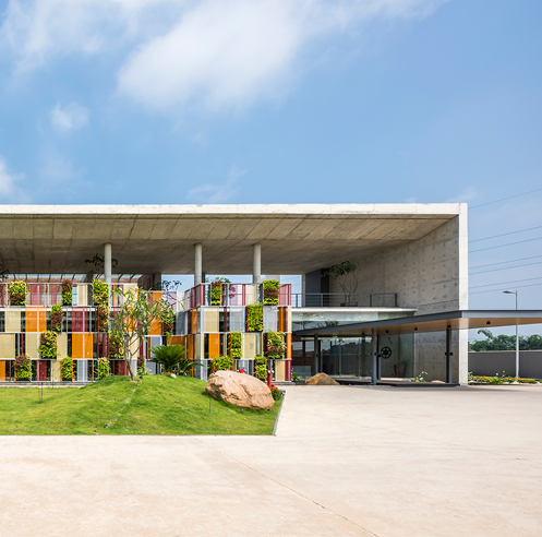 Studio VDGA's tropical twist to the architecture of factory-cum-office in Hanoi