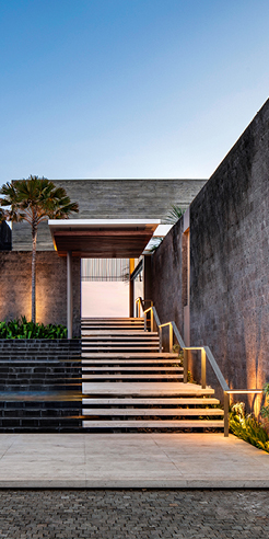 SAOTA perches a stunning resort-inspired house atop a rocky cliff in Bali