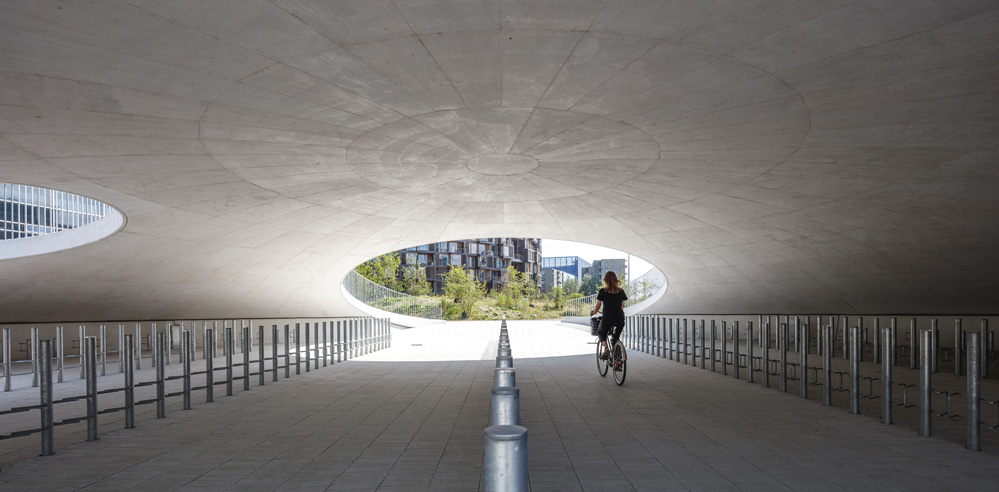 COBE creates a landscape of hollow hills for a bicycle parking space in Copenhagen