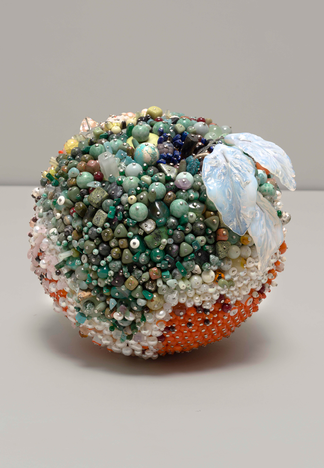 Kathleen Ryan, Serpentine Foam, Serpentine, smokey quartz, aventurine, Ching Hai jade, agate, marble, amazonite, magnesite, calcite, onyx, and other precious stones, 14.5 x 16.5 x 16.5, 2019 | Kathleen Ryan | STIRworld