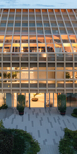 A timber grid inspired by Chinese roofs enfolds Sanya Farm Lab by CLOU architects