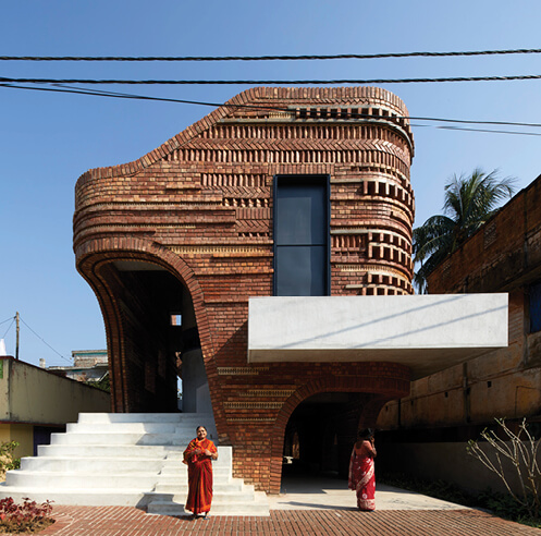 Abin Design Studio clads Gallery House in India in ceramic inlaid terracotta bricks