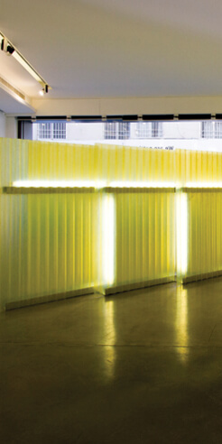 Abstract urban symbols of Nathaniel Rackowe's installations are laced with lights