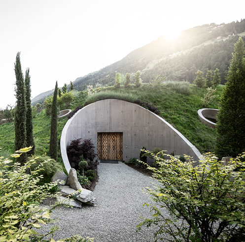 Apfelhotel Torgglerhof by noa* architecture sits amid the mountains and apple trees