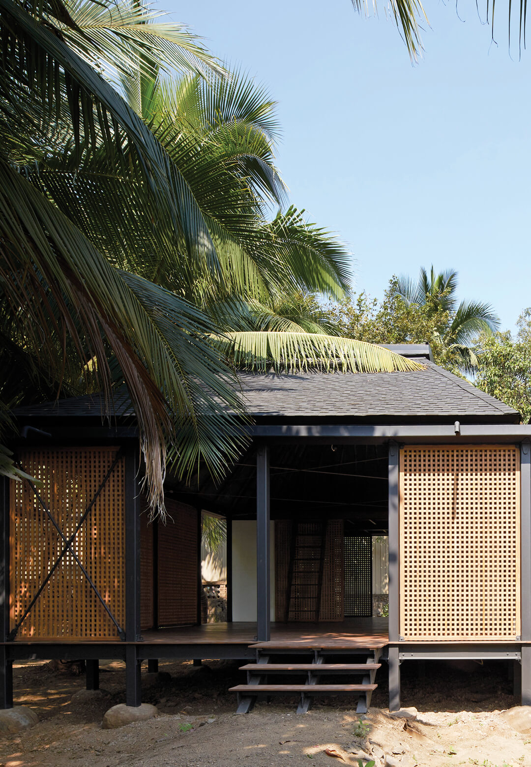 Designed by Architecture BRIO, Mumbai Artist Retreat sits nestled between palm trees in Alibag, India | Mumbai Artist Retreat by Architecture BRIO | STIRworld