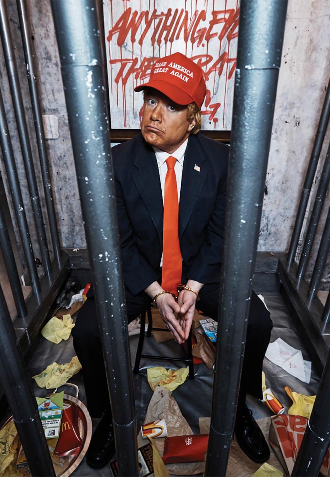A Trump impersonator in a cell constructed by INDECLINE   The People's Prison   INDECLINE   STIRworld